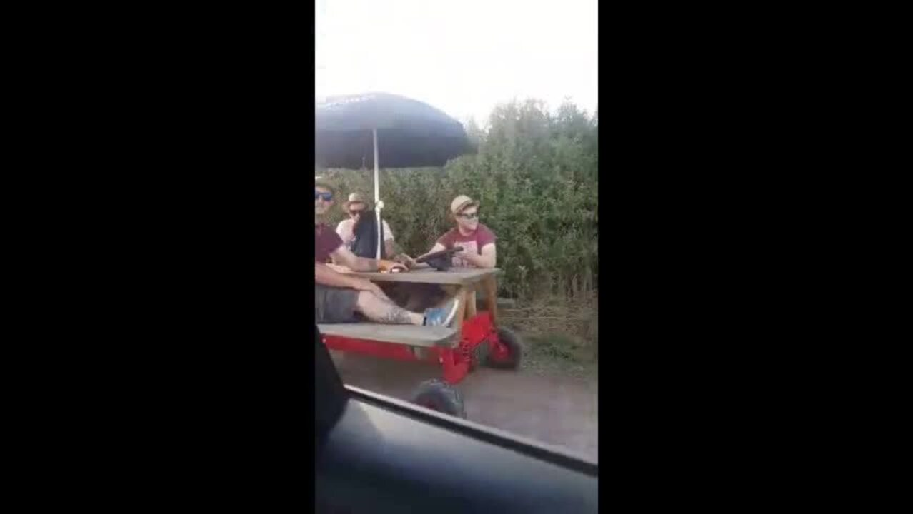 LAD Drives Drinkers Around Steam Fair On Motor Powered Pub Bench