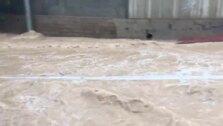 La rambla de Churra, desbordada por las lluvias