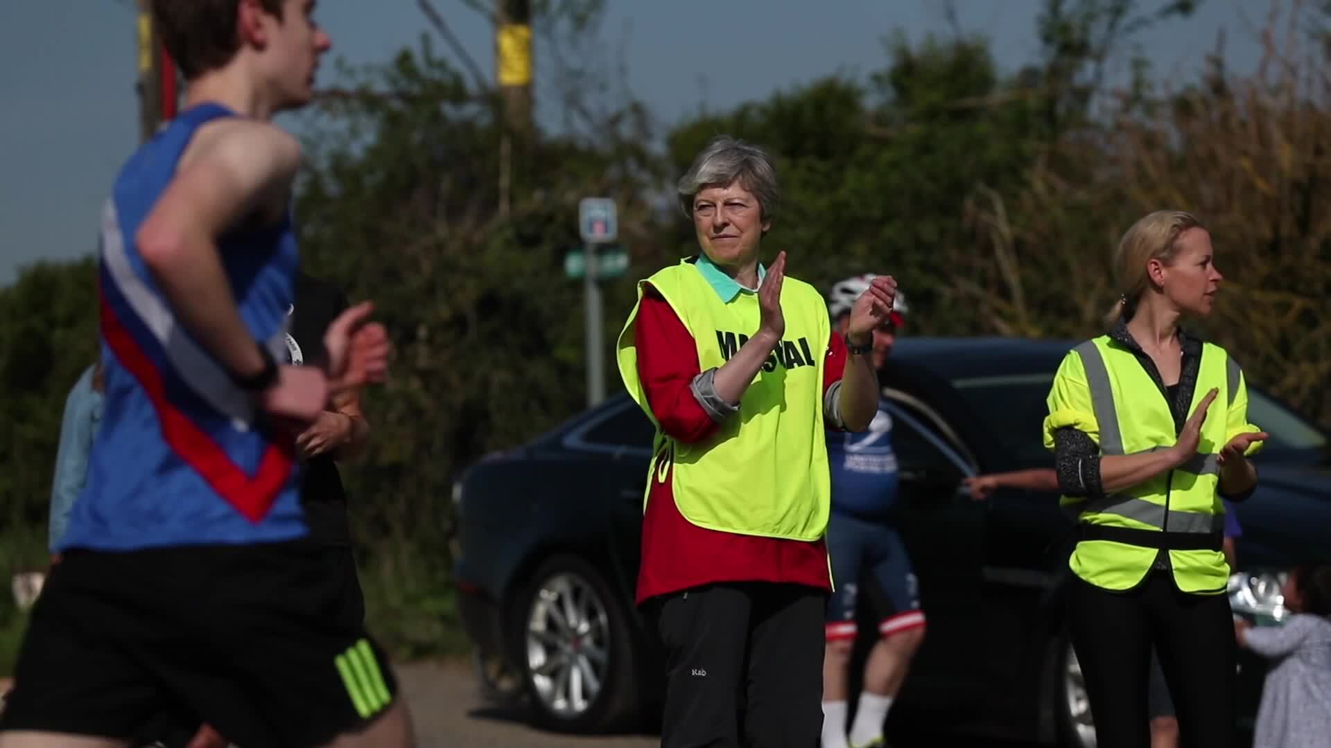 Theresa May spotted marshalling 10k Easter race in Maidenhead