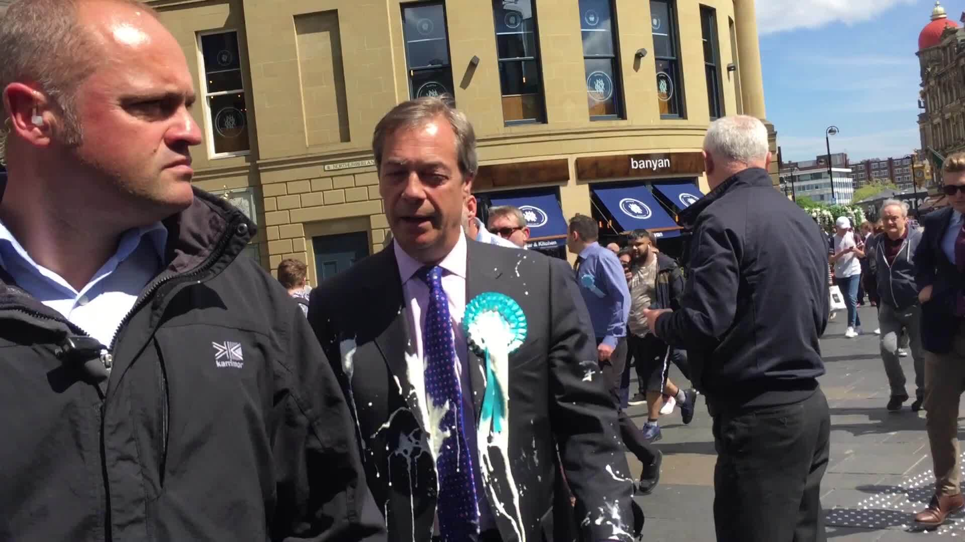 Nigel Farage hit by milkshake while campaigning for European elections in Newcastle