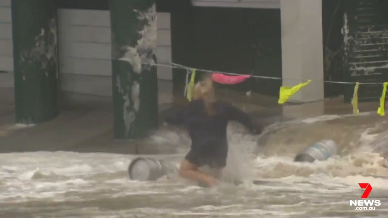 Woman risks life to save beloved beer kegs by jumping into floodwater  during storm - Daily Star