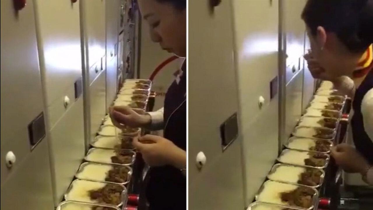 d59de38ad1 Flight attendant is filmed taking bites out of in-flight meals – The Sun