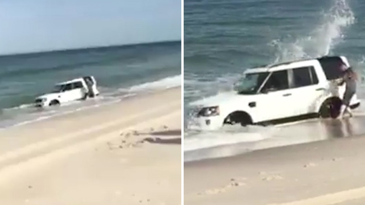 Owner battles against the tide to dig his Land Rover