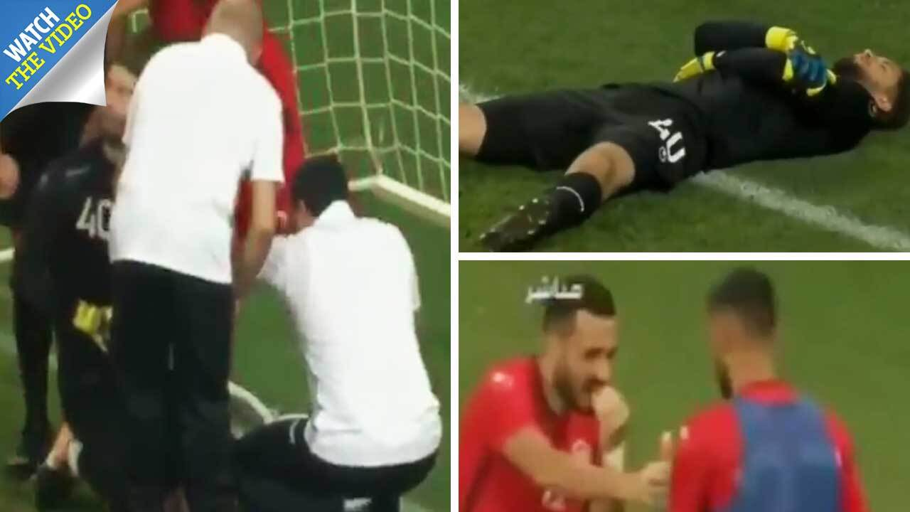 90bd65f28 Tunisia goalkeeper Mouez Hassen  fakes  injury during World Cup warm-up so  team-mates can break Ramadan fast