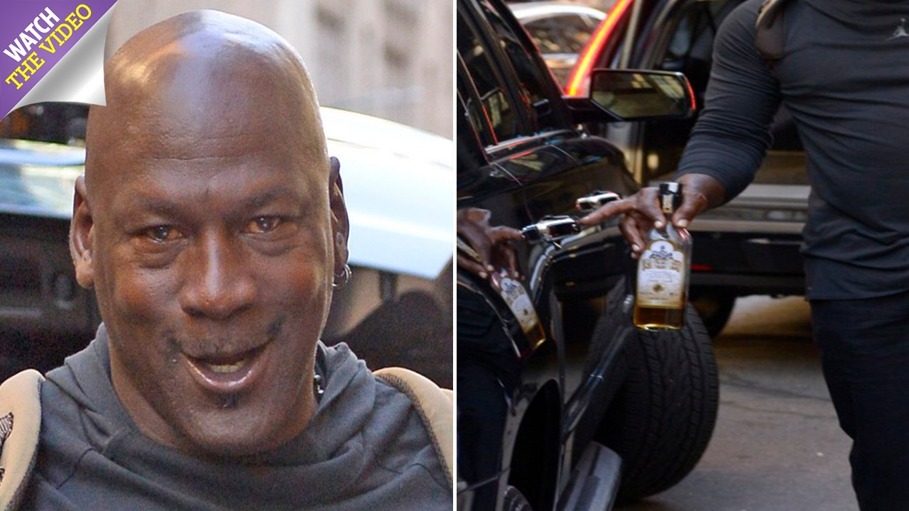 030dbb4e126599 Michael Jordan carries half empty bottle of Tequila and a pillow as he checks  out of New York hotel – The Sun