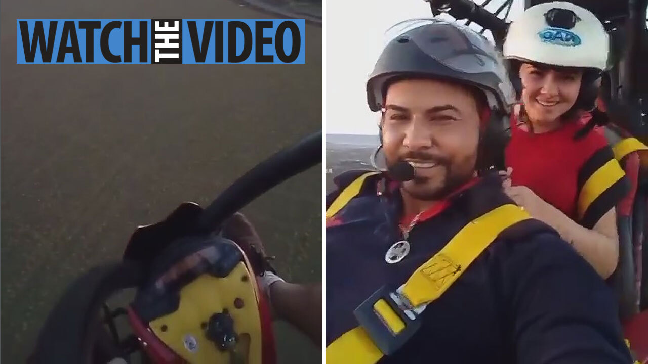 Bride and groom film themselves paragliding moments before