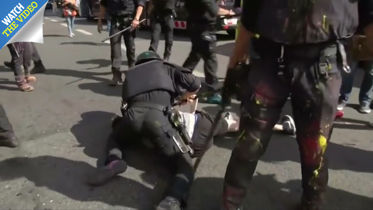 Ada Colau En Porno fourteen injured in police clashes as protesters hurl